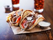 greek gyros with tzatzikii sauce and fries