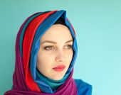 foto of middle eastern culture  - Beautiful Middle eastern girl with a scarf on red and blue - JPG