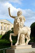 centaur on bridge and palace in Pavlovsk park St. Petersburg Russia
