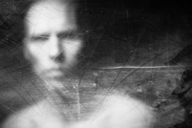 picture of scary face  - Blurry human face behind dusty scratched glass - JPG