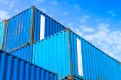 Blue Metal Industrial Cargo Containers Are Stacked
