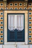 Typical window of old architecture in Lisbon Portugal