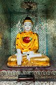 Buddha statue in Burma famous sacred place and tourist attraction landmark - Shwedagon Paya pagoda. Yangon, Myanmar