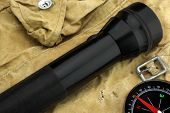 Pocket Searchlight And Compass On Backpack