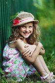 Happy Little Girl In A Straw Hat