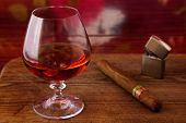 alcohol and cigar on a wooden table
