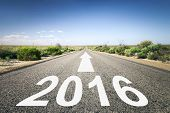 An image of a road to the horizon with number 2016