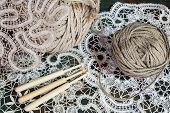 Lace with a ball of yarn and sticks
