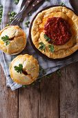 Meat Pies On The Table. Vertical View Above, Rustic Style