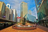 HONG KONG, DECEMBER 11, 2014: Hong Kong Special Administrative Region. The modern city on the ocean coast. Square in downtown decorated with a fountain and an abstract sculpture