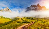 Great view of the foggy Tofane mountain range from Falzarego pass. National Park. Dolomites (Dolomiti), South Tyrol. Location Cortina d'Ampezzo. Italy, Europe. Dramatic scene. Beauty world.
