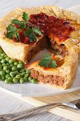Pieces Of Meat Pie And A Garnish Of Green Peas. Vertical