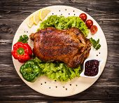 stock photo of roast duck  - Roast duck on cutting board - JPG