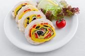 Chicken meat and vegetables roll appetizer