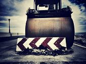 dramatic shot of a paving roller