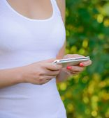 Woman Using her Mobile Smart Phone Outdoors