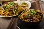 image of stir fry  - Stir Fry Singapore Noodles with bio herbs and microgreens vegetable - JPG