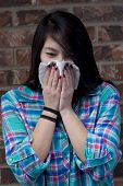 Young Woman Blows Her Nose.