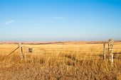 image of kansas  - A Prairie Blessing sign on a barbwire fence in the prairie of the Flint Hills of Kansas - JPG
