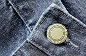 Denim pants with detail of brass button and seams