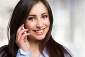 picture of people talking phone  - Portrait of a young woman talking on the phone - JPG