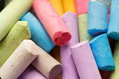 Colorful crayons for drawing on the pavement close-up