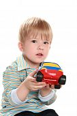 Child With A Toy Car
