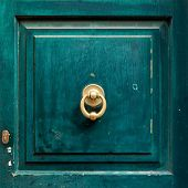 stock photo of door  - Dark green wooden door panel with door knocker - JPG