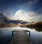 Pier under moon