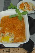 Baked fish with grated sweet potatoes