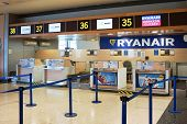 VALENCIA, SPAIN - FEBRUARY 14, 2015:  A Ryanair check-in counter at the Valencia airport. In 2014, Ryanair was the largest European airline by scheduled passengers carried.