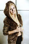 Beautiful Blonde Girl In Fur With Hood