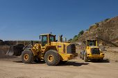 pic of bulldozers  - bulldozer in action in a big quarry - JPG