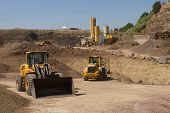 foto of bulldozers  - bulldozer in action in a big quarry - JPG