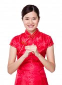 Chinese woman with blessing good luck gesture