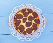 Russian Chocolate Cheesecake On A Blue Wooden Background