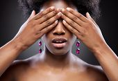 Black Beauty Covering Eyes With Both Hands