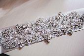 Bridal belt with shiny rhinestones. Wedding luxury accessories