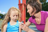 stock photo of inhalant  - mother using inhaler with her asthmatic daughter - JPG