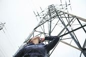foto of electricity pylon  - A woman at the bottom of a electricity pylon - JPG