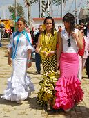 Three Spanish women in traditional dress.