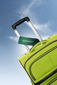 Somewhere. Green Suitcase With Label