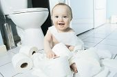 picture of toilet  - Toddler ripping up toilet paper in bathroom - JPG