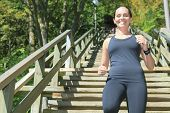 Runner athlete running on stairs. woman fitness jogging workout