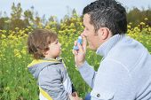picture of inhalant  - A dad give inhaler for respiratory system issues - JPG