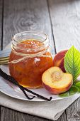 stock photo of peach  - Peach vanilla jam with fresh peaches on table - JPG