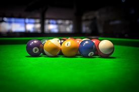 foto of pool ball  - Billiard Balls. A Vintage style photo from a billiard balls in a pool table. Noise added for a film effect