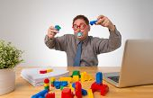 picture of pacifier  - Mature businessman with a pacifier playing in the office - JPG