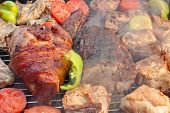 picture of baby back ribs  - Mixed Meat And Vegetables On The Hot BBQ Charcoal Grill - JPG