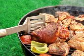 picture of bbq party  - Spatula BBQ Assorted Meat And Vegetables On The Hot Flaming Grill - JPG